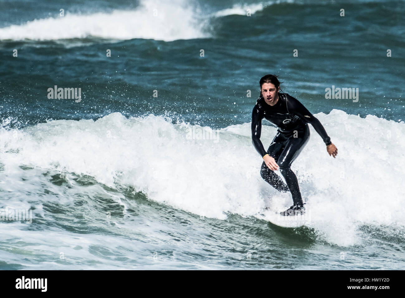 "A surfer in Klitmoller which is a popular surfing destination in Northern Denmark. Klitmoller is also known as ""Cold - Stock Image"