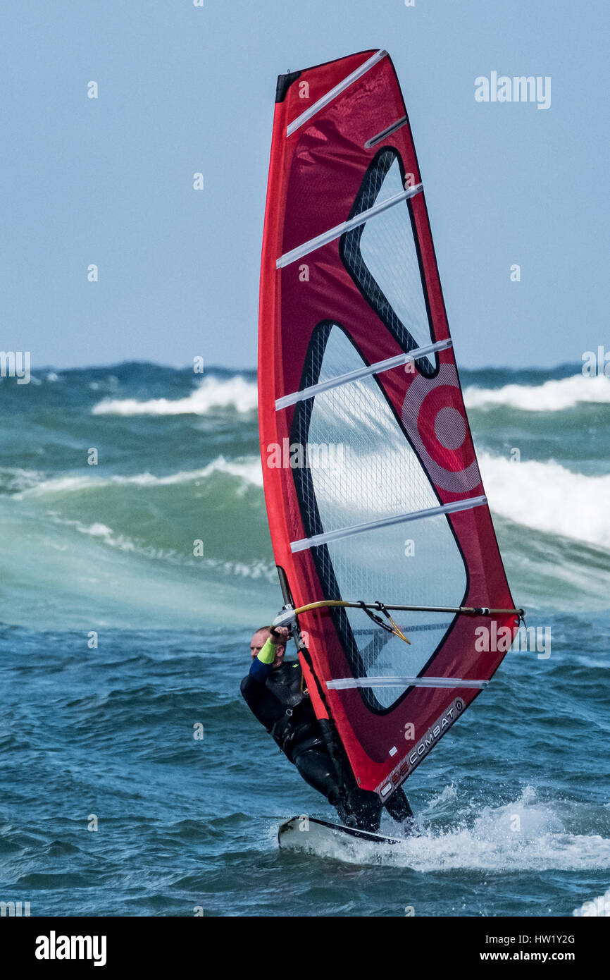A windsurfer in Klitmoller which is a popular windsurfing destination in Northern Denmark. Klitmoller is also known - Stock Image