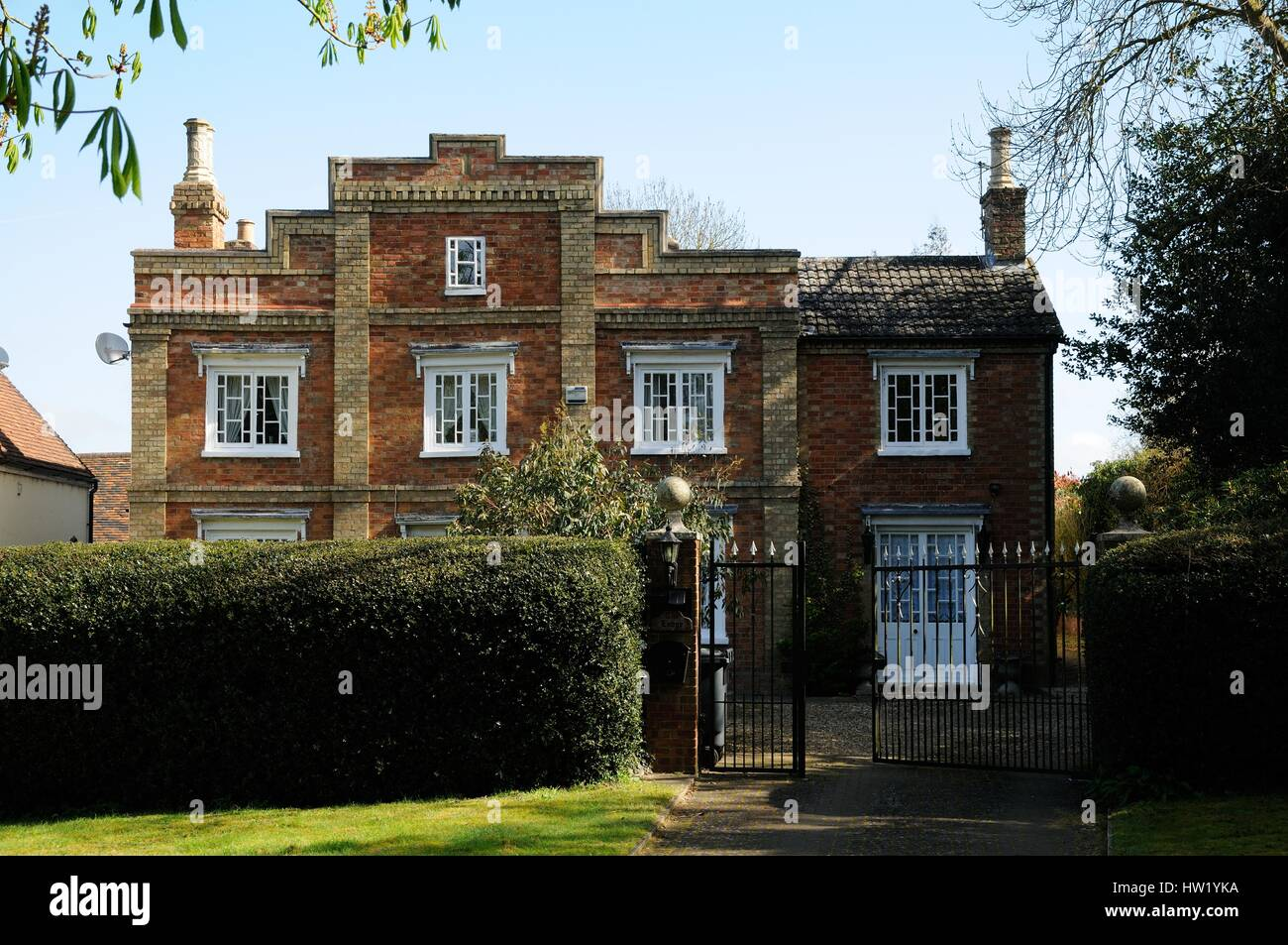 The Lodge, Husborne Crawley, Bedfordshire, is a brick building, with finely proportioned windows, a parapet roof, - Stock Image