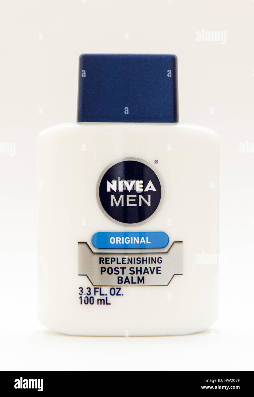 Bottle of Nivea post shave balm stands against white background. - Stock Image