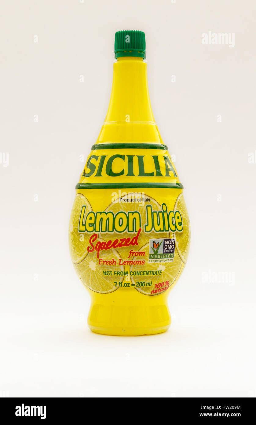Bottle of Sicilia lemon juice isolated on white background. - Stock Image