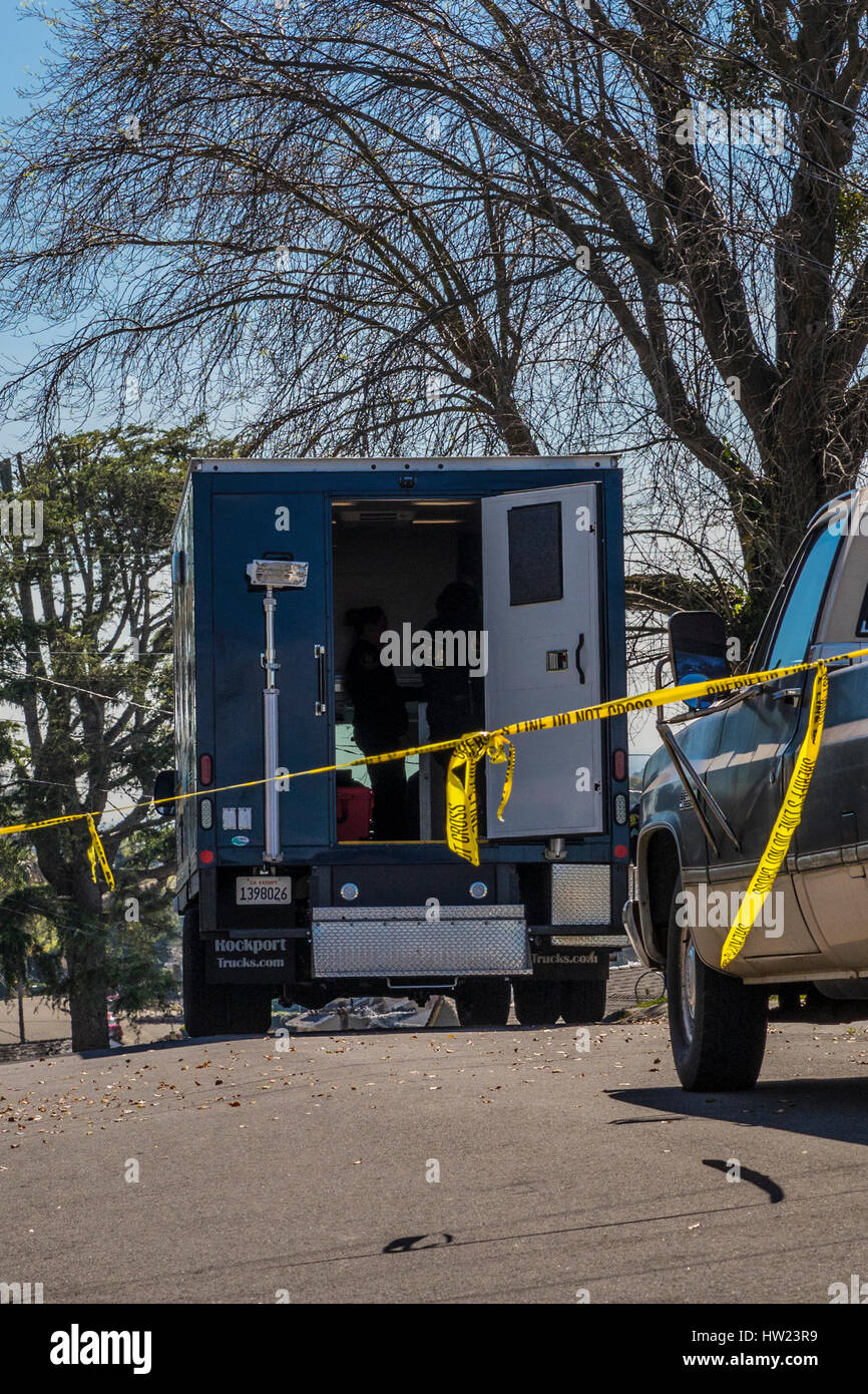 A crime scene with forensic experts where a drug related murder occurred after a noisy fight broke out in a quiet - Stock Image