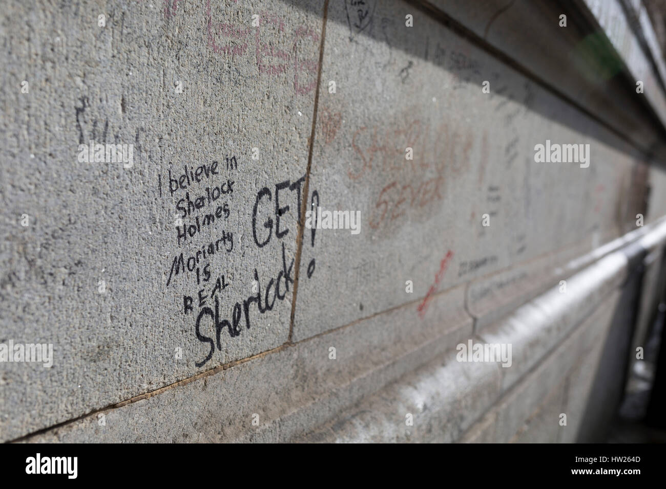 Graffiti scrawled on the exterior of Barts Hospital, by fans of the popular TV show Sherlock starring Benedict Cumberbatch - Stock Image