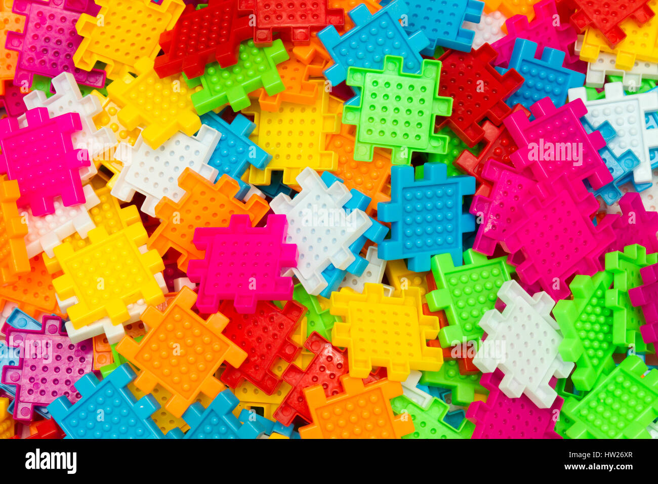 Some colorful jigsaw puzzle pieces close up. - Stock Image