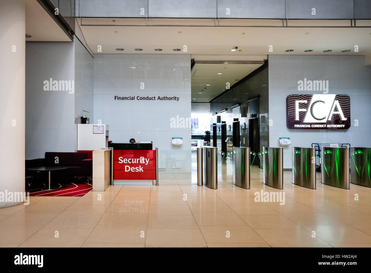 Entrance lobby of the Financial Conduct Authority (FCA) building at Canary Wharf, one of London's two financial Stock Photo