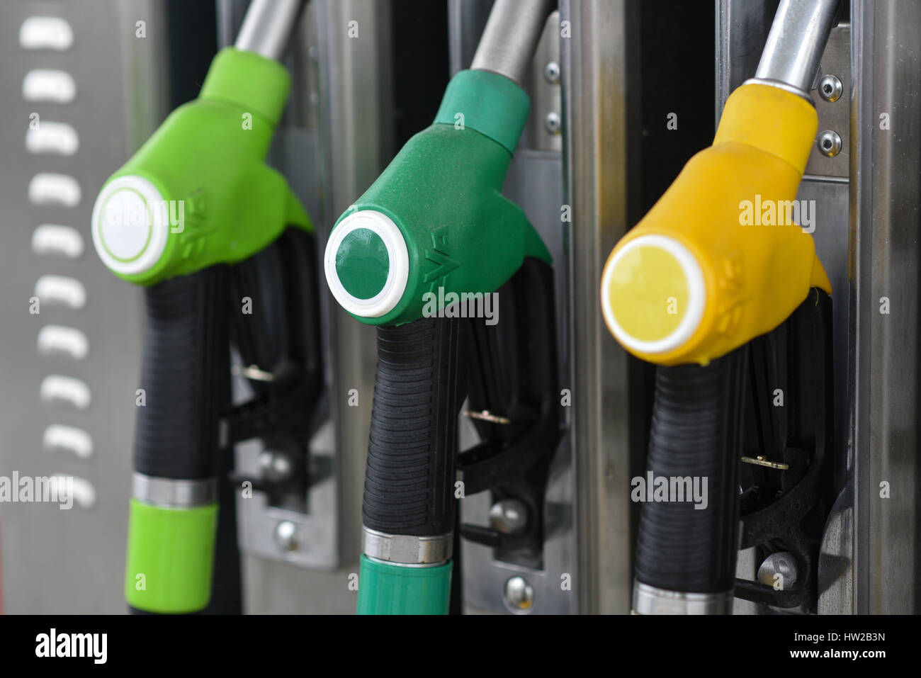 Nozzles on a fuel dispenser machine at a petrol station Stock Photo