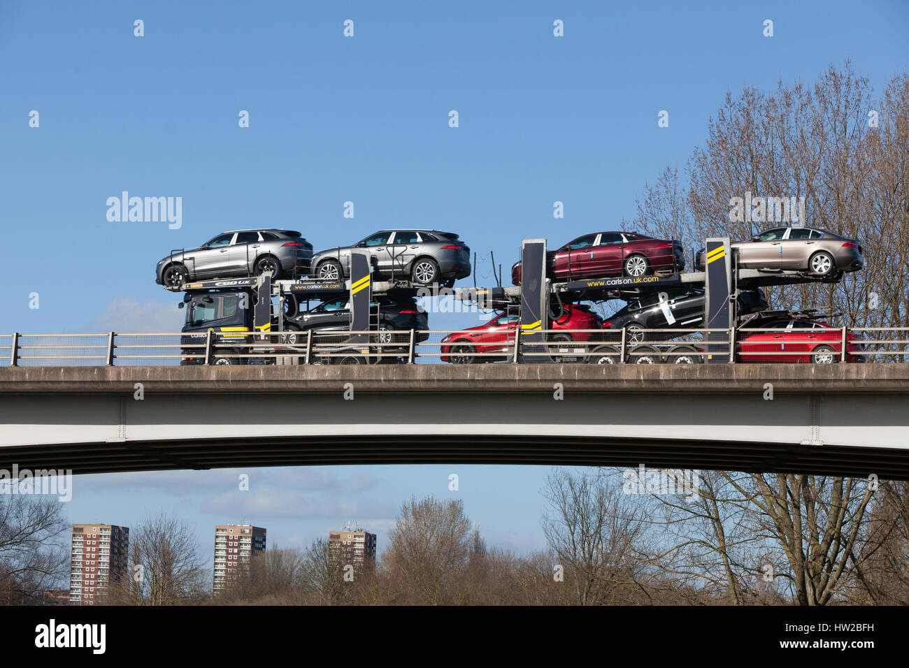 High value cars on a car transporter in the Midlands - Stock Image