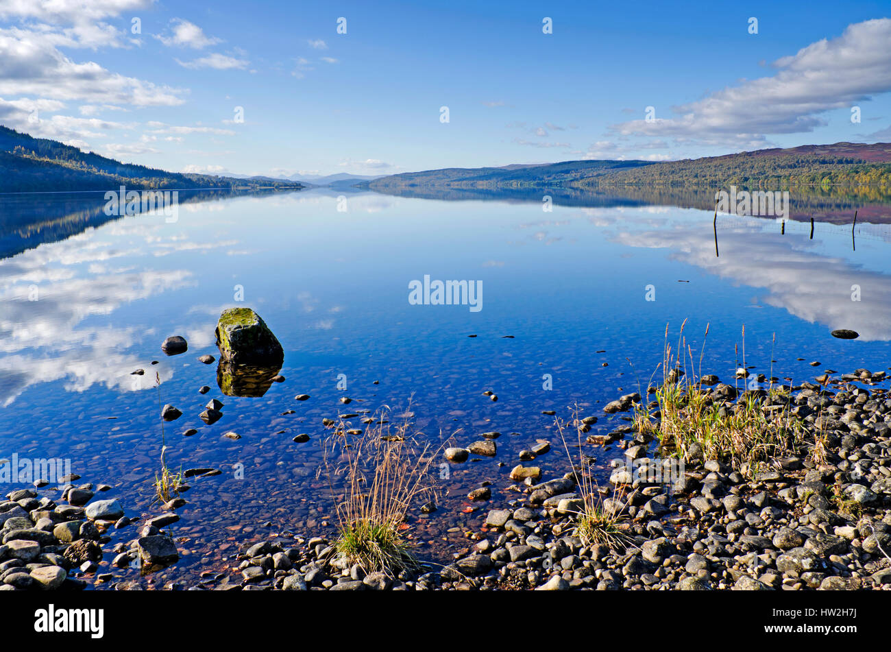 A view along the length of Loch Rannoch, Perthshire, Scottish Highlands, from the shore near Kinloch Rannoch, on - Stock Image
