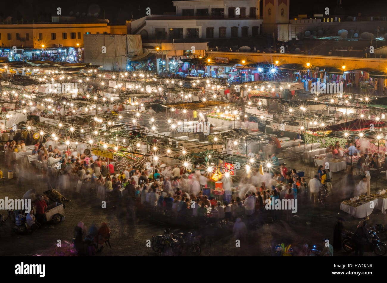 Famous square Jemaa El Fna busy with many people and lights during the night, medina of Marrakesh, Morocco Stock Photo