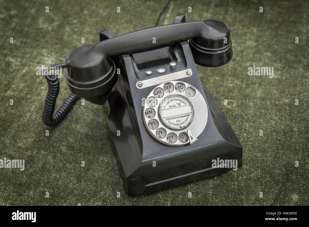 Old fashioned bakelite type plastic phone handset with rotary dial. - Stock Image