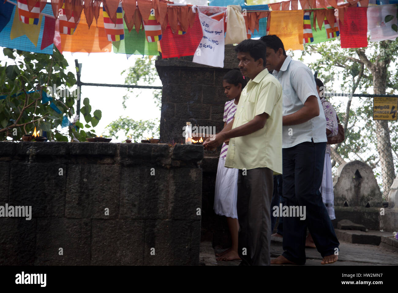 Dambulla Sri Lanka People Lighting Butter Lamps By Bo Tree - Stock Image