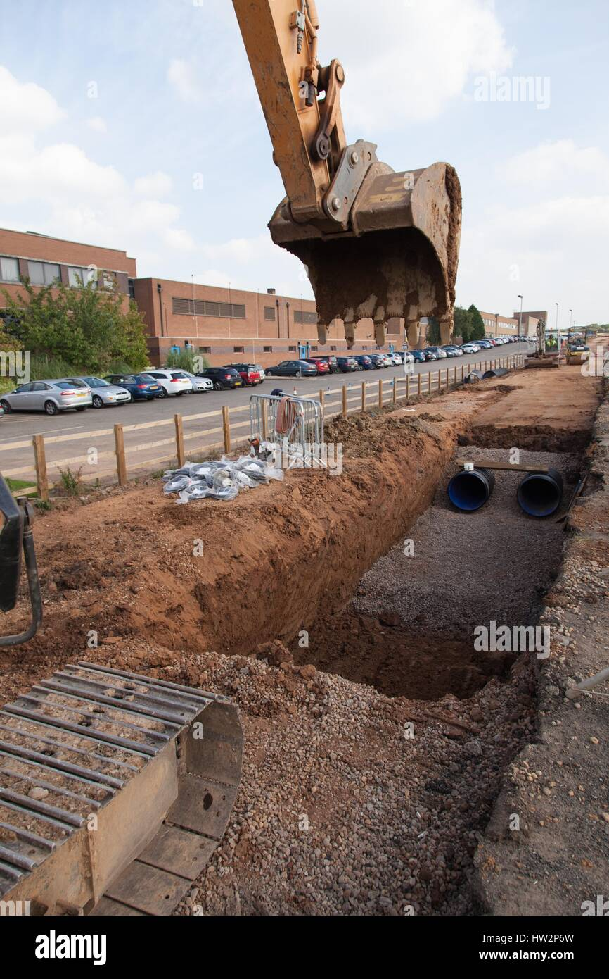 Drainage pipework being installed under a new section of the A5 near Nuneaton. Civil engineering, road construction, - Stock Image