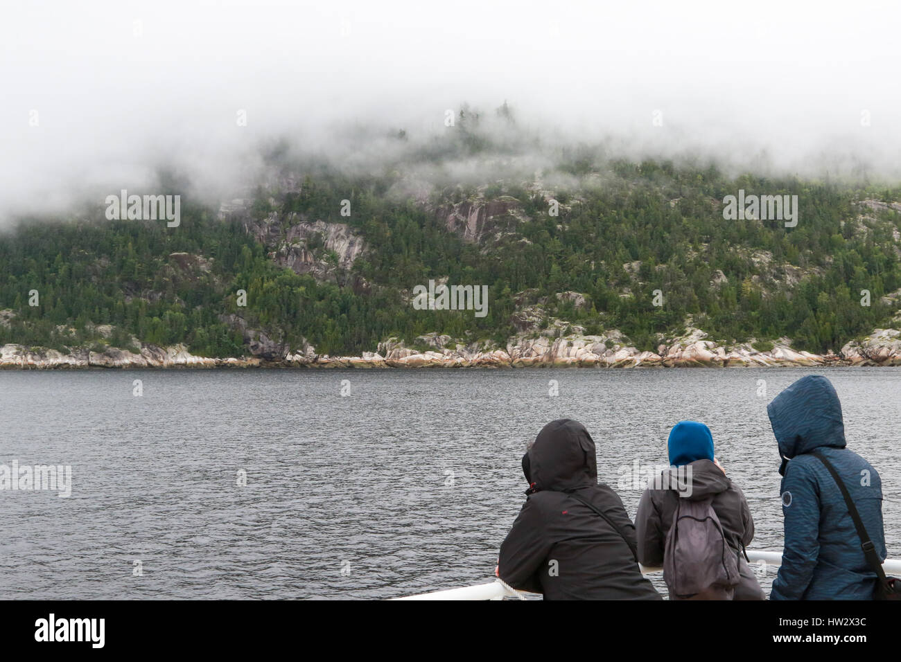 Low overcast aboard tour boat in Saguenay Fjord - Stock Image