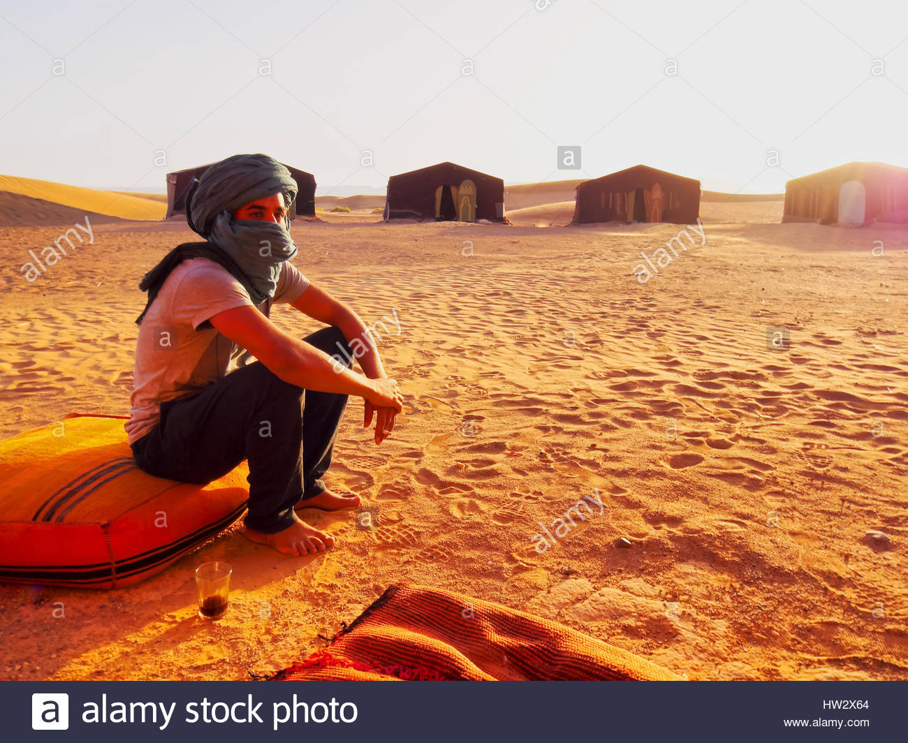ZAGORA DESERT, MOROCCO, MAY 04: Unidentified Berber man sitting in front of the tent on the Zagora Desert in Morocco, - Stock Image