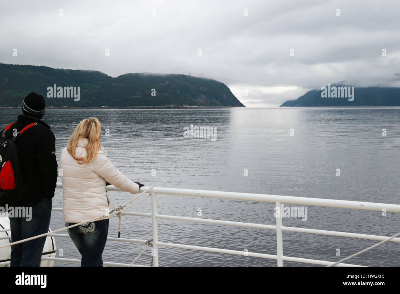Two passengers on a tour boat in Saguenay Fjord - Stock Image
