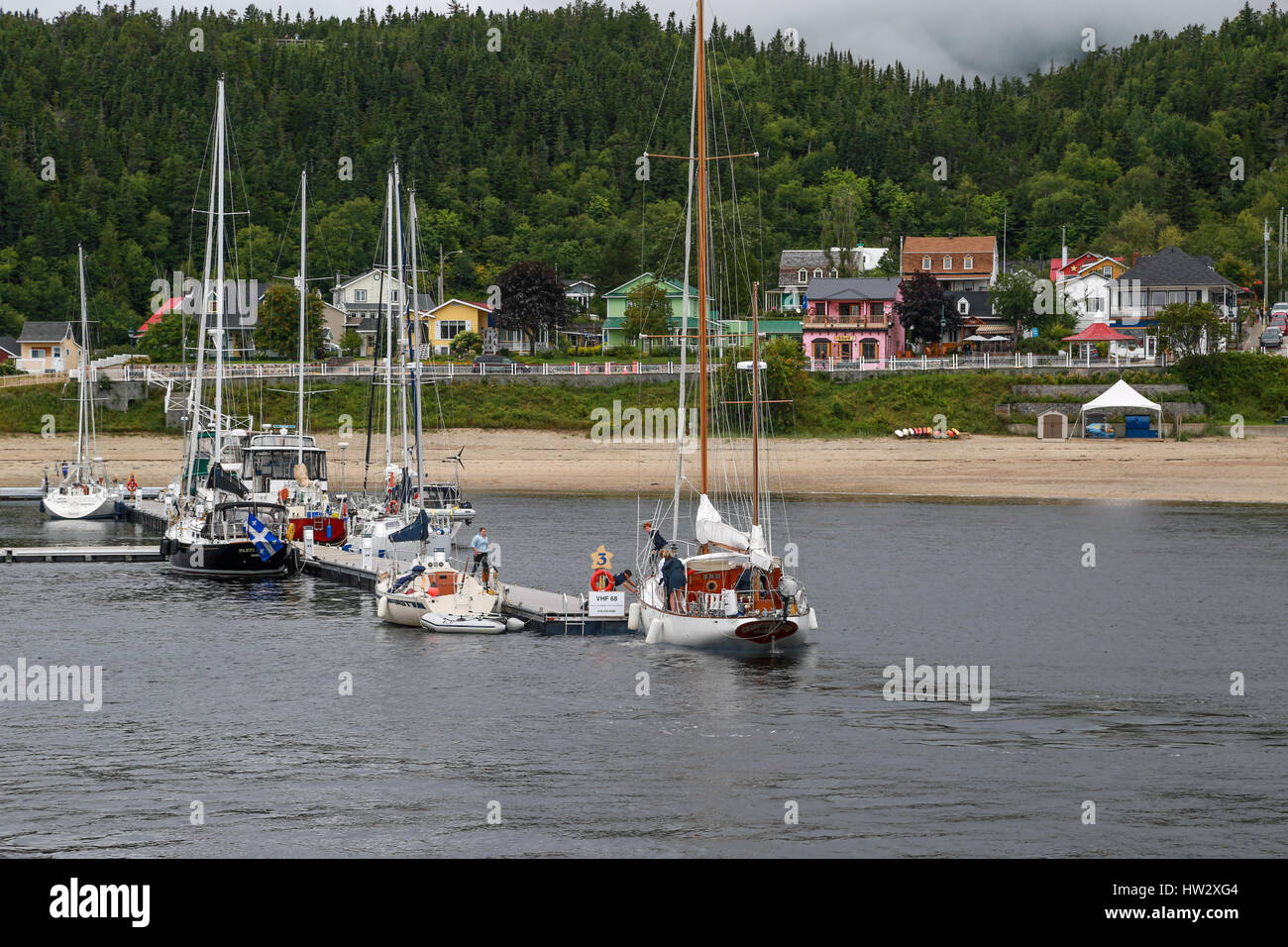 Sailing yachts on a float at Tadoussac - Stock Image