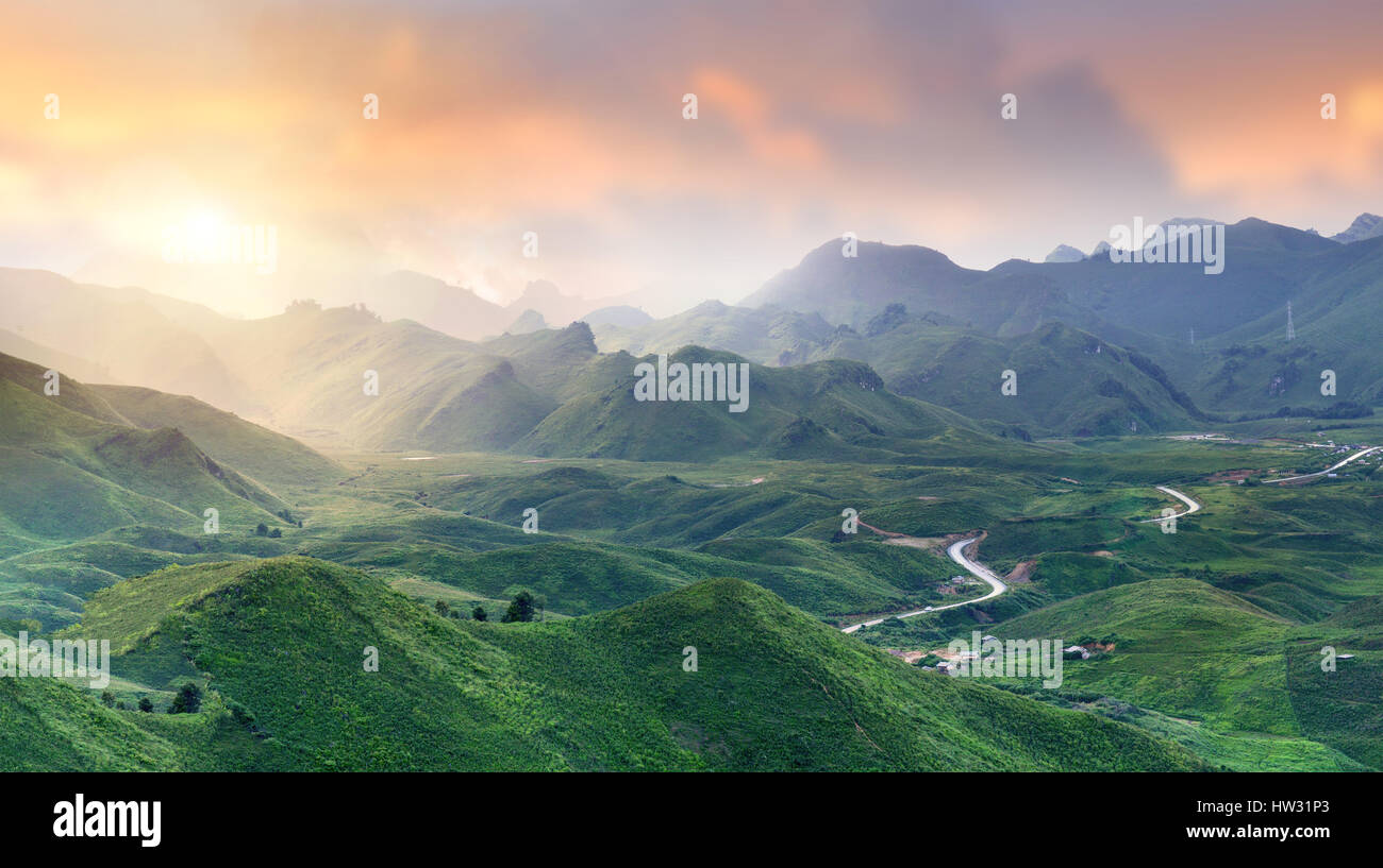 Mountain road view in the north of Laos wide and cloudy low lighting after raining in the morning. - Stock Image