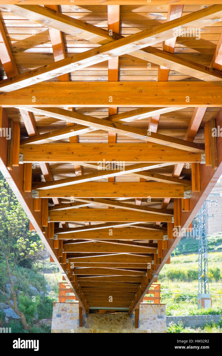 View of the nerves of the lower structure of a wooden bridge of a city - Stock Image