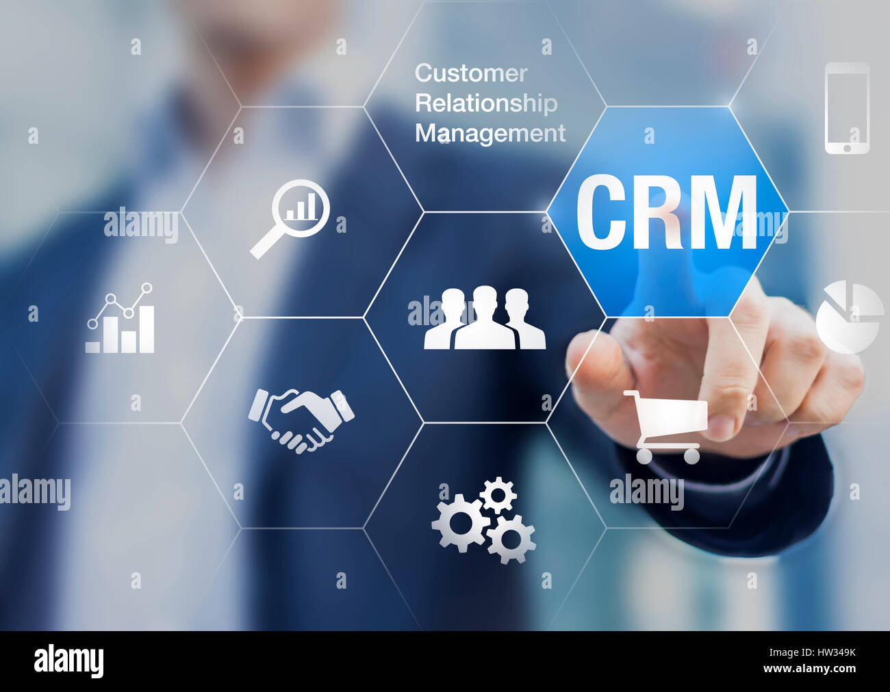 Customer relationship management concept with businessman touching button in background, communication, marketing - Stock Image