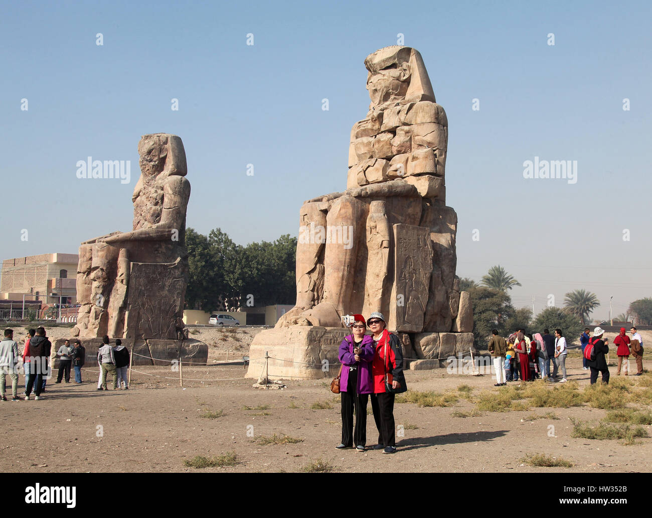 Colossi of Memnon on the the West Bank of the Nile at Luxor in Egypt Stock Photo