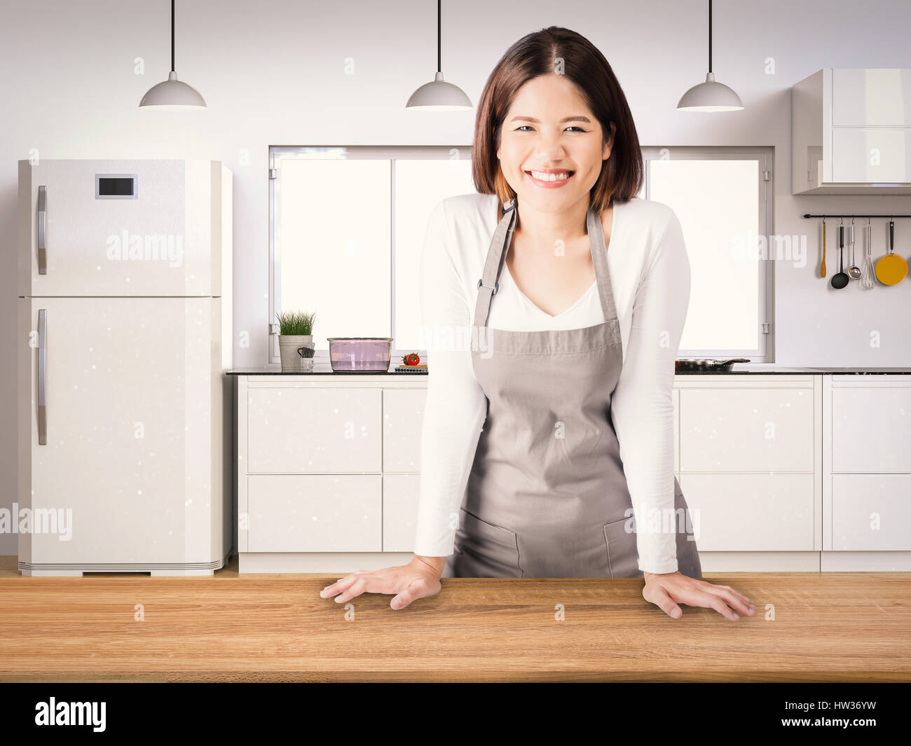 asian housekeeper with kitchen background Stock Photo: 135910317 - Alamy