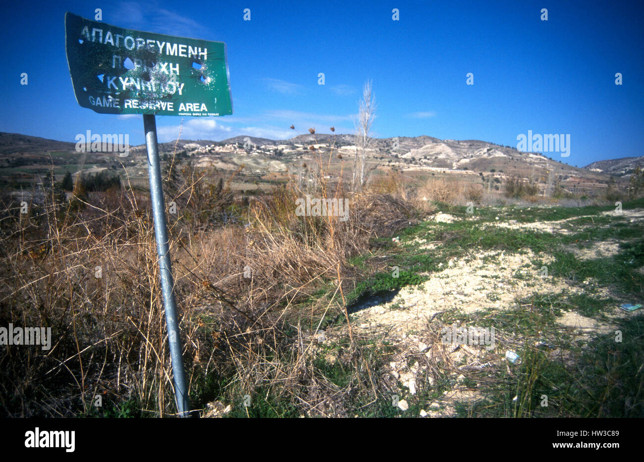 Cyprus. Hunters shoot 'Game Reserve Area sign'       full of holes. Songbirds beware! - Stock Image