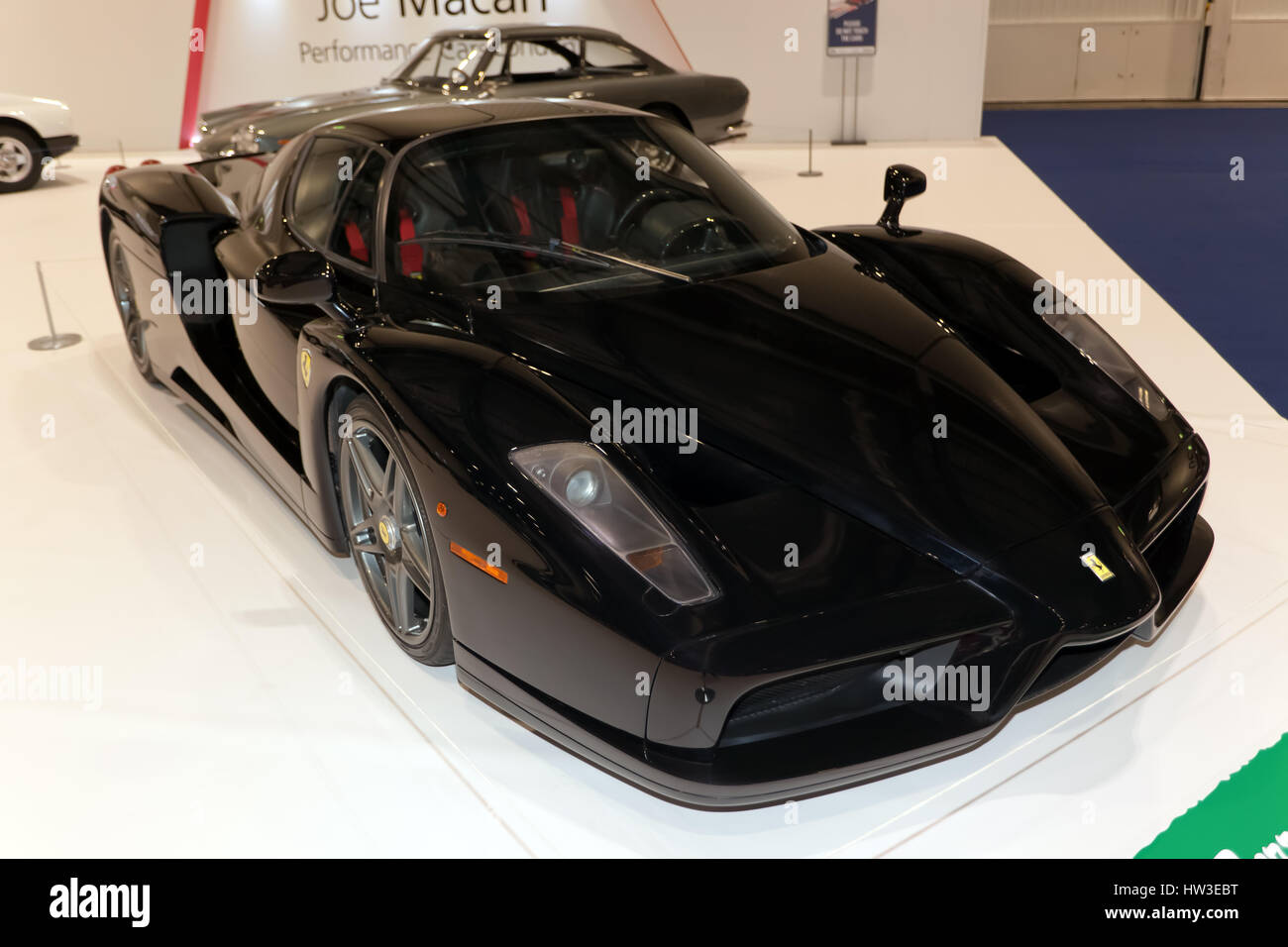 View of a black Enzo Ferrari, part of the Ferrari Tribute Collection, at the 2017 London Classic Car Show. - Stock Image