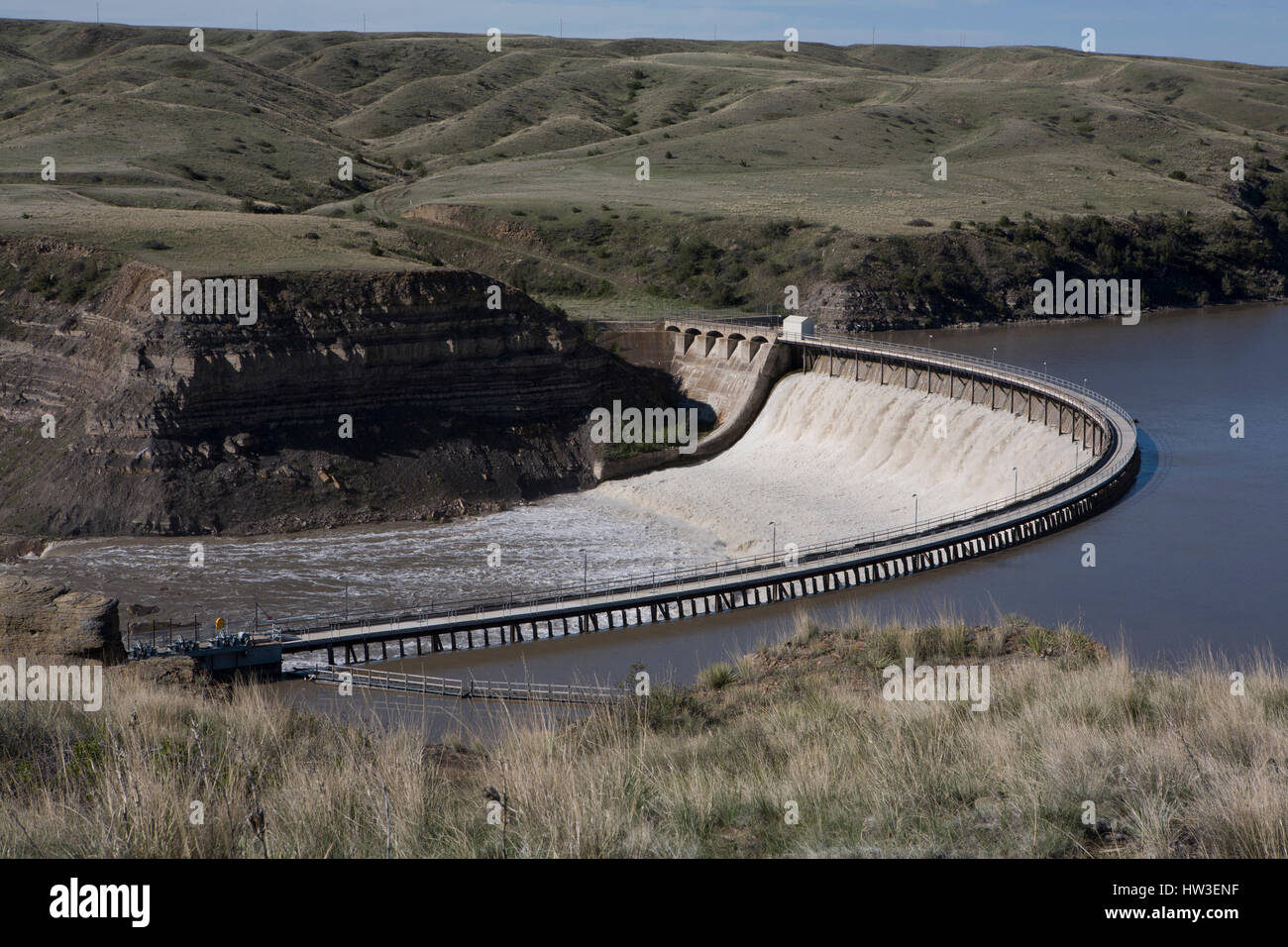 Graceful arc of Ryan Dam on the Missouri River. - Stock Image