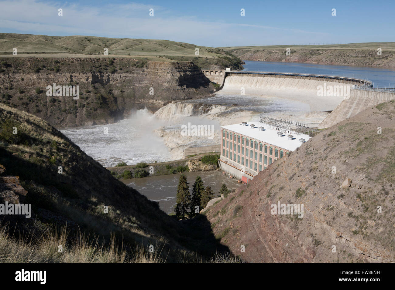 Water flows over Ryan Dam and the Great Falls of the Missouri River in this view from River's Edge Trail. - Stock Image