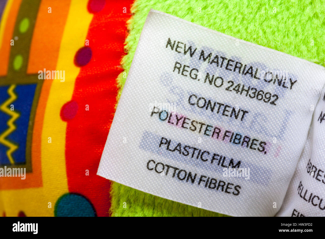 new material only content polyester fibres, plastic film, cotton fibres - Information on label on Lamaze Rusty the - Stock Image