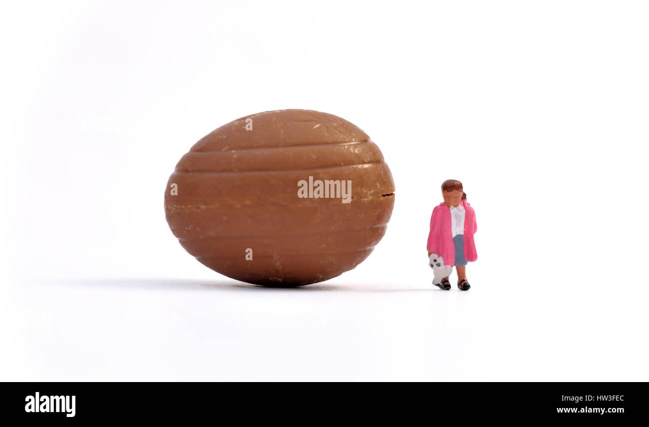 chocolate eggs and miniature figurine girl Stock Photo