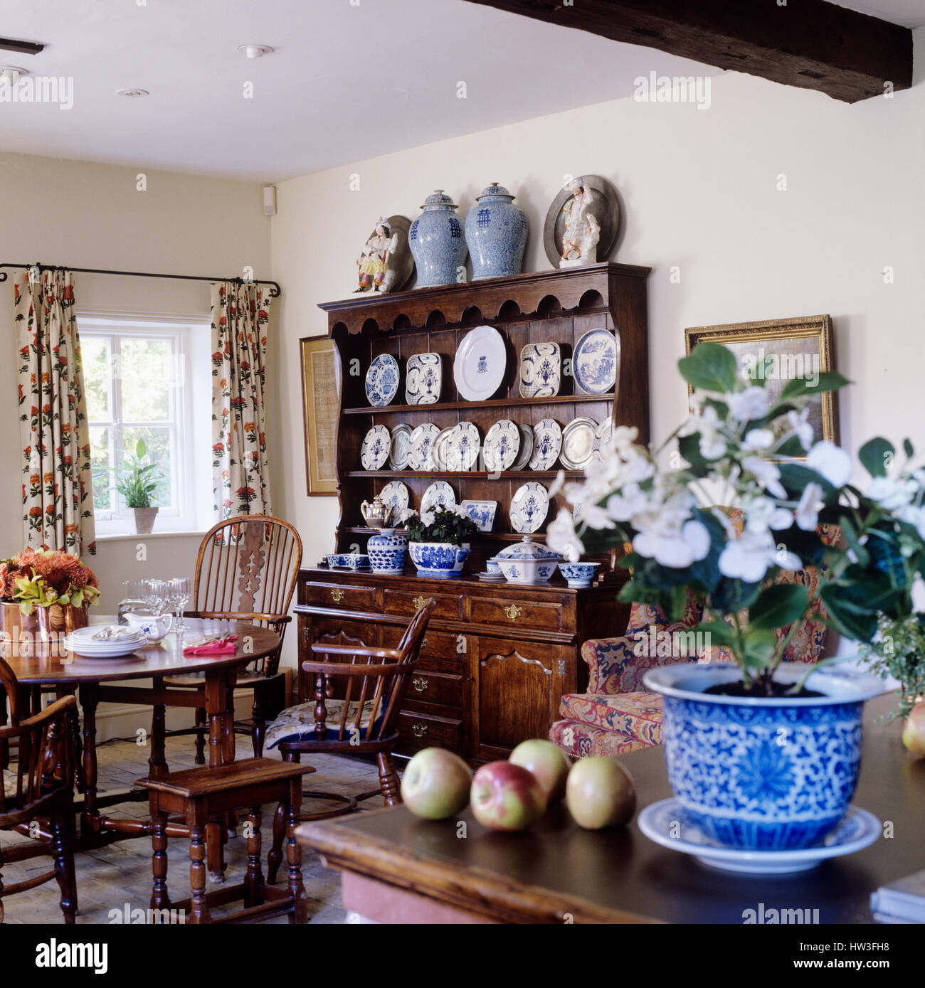 Dining room with shelves of plates on display Stock Photo ...