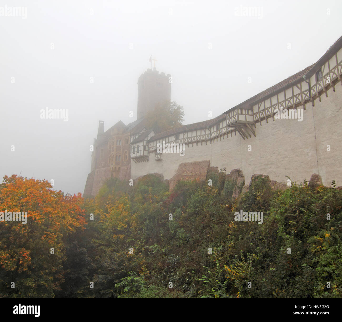 Wartburg im Nebel;  Wartburg Castle in autumn  mist:  During his exile on this castle (May 1521 to March 1522) Martin - Stock Image
