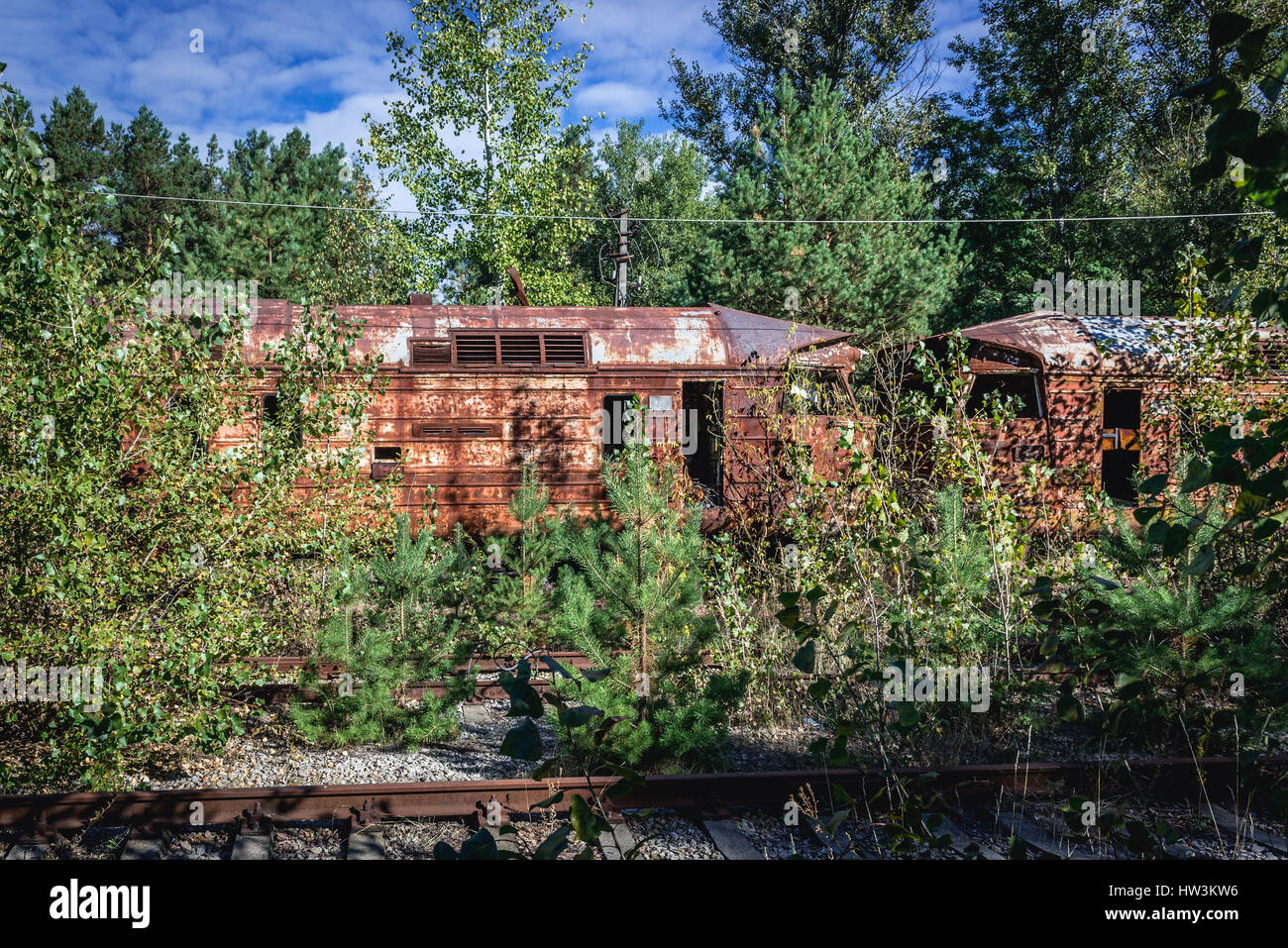 Rusty wagons in abandoned Yaniv town railway station, Chernobyl Nuclear Power Plant Zone of Alienation around the - Stock Image