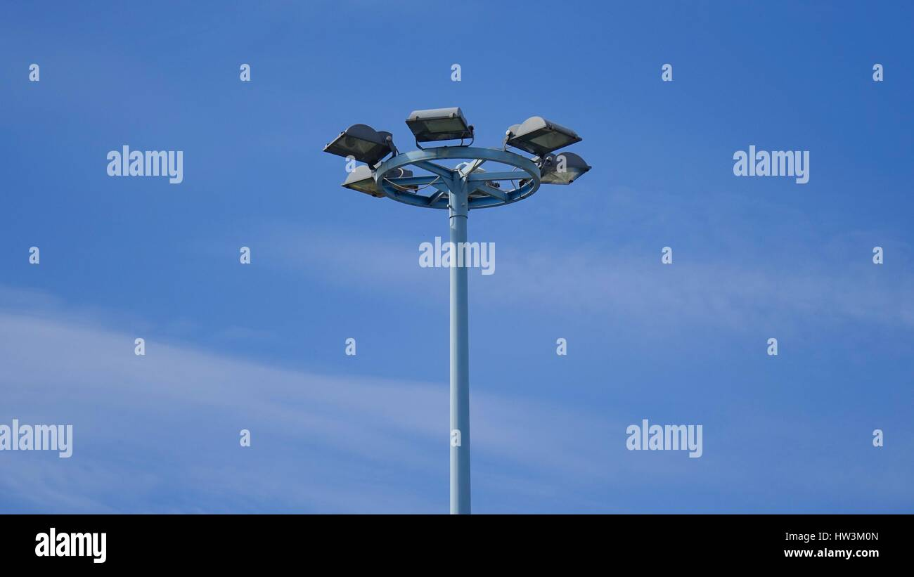Street lamp in day parking area - Stock Image