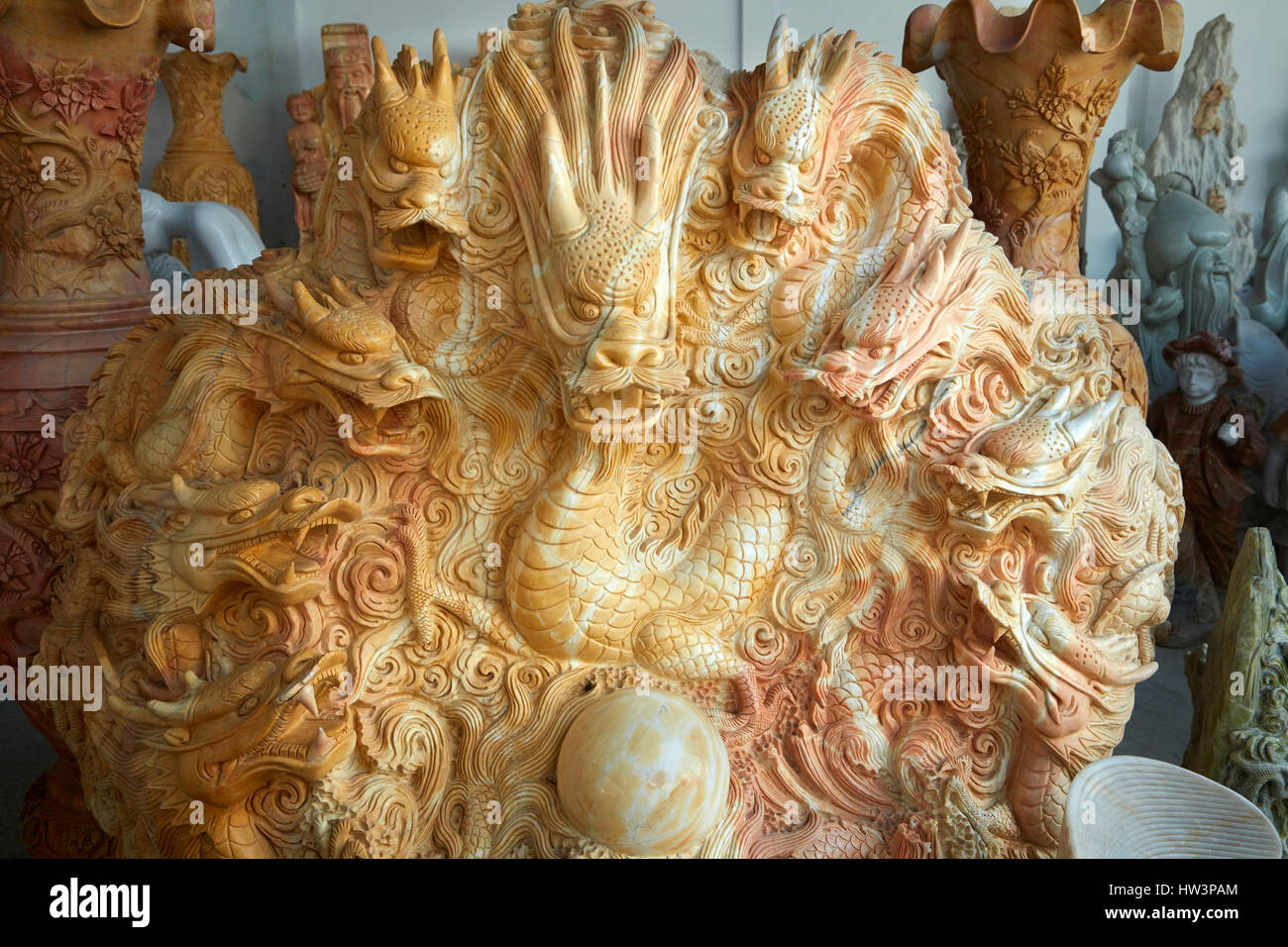 Hand crafted marble dragon sculpture at tourist shop, Marble Mountains, Da Nang, Vietnam - Stock Image