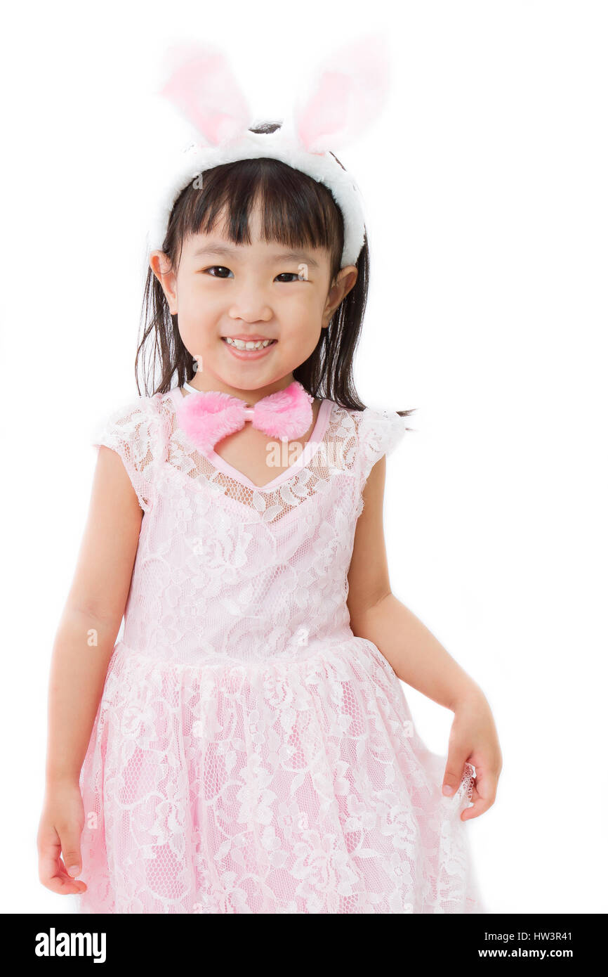 Chinese Little Girl in banny costume on plain white isolated background. - Stock Image