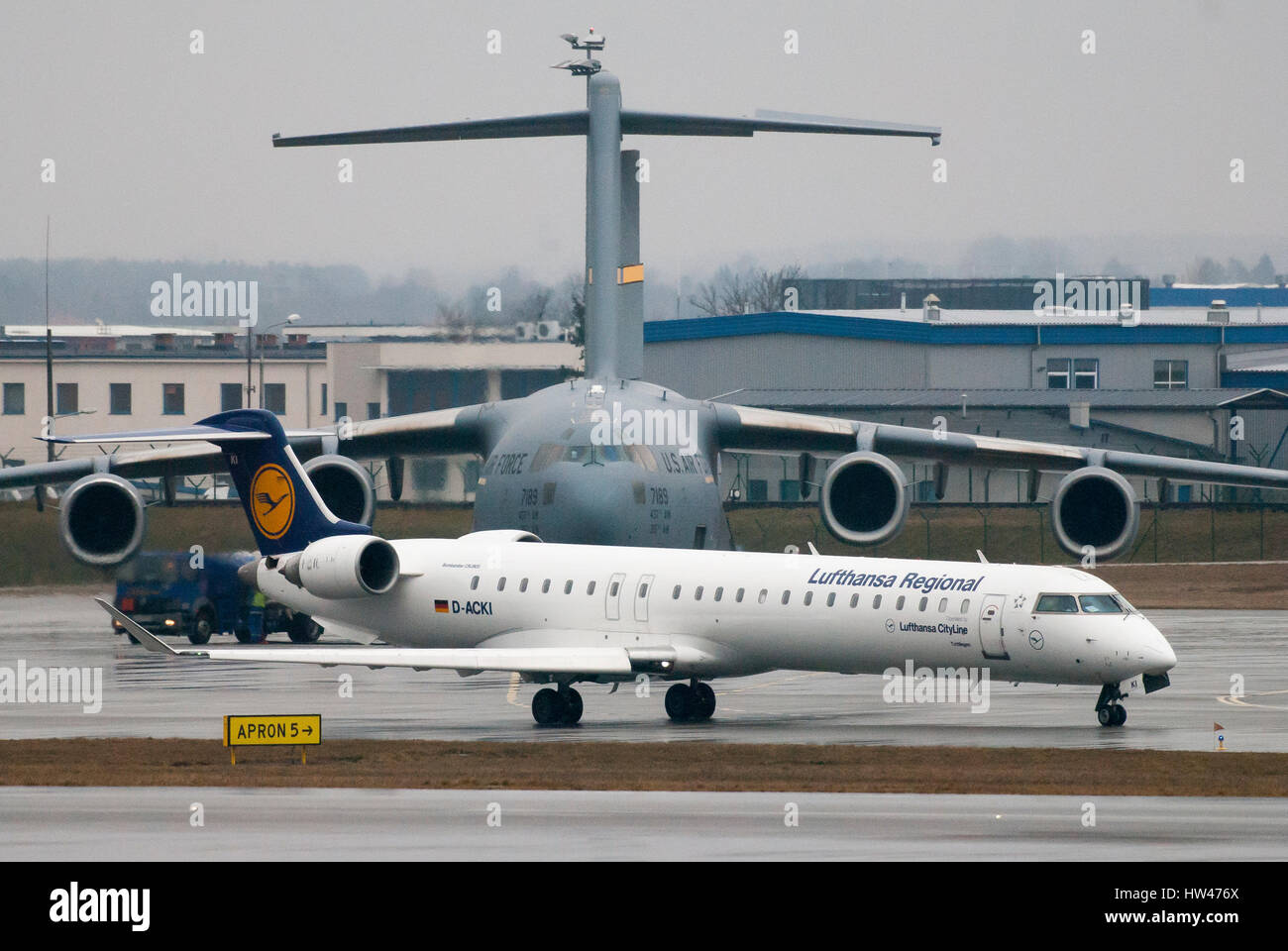 Gdansk, Poland. 17th Mar, 2017. Luftansa Regional aircraft Bombardier CRJ-900 and United States Air Force large - Stock Image
