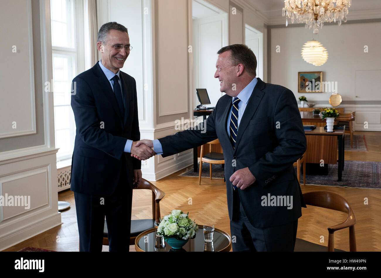 NATO Secretary General Jens Stoltenberg (L) and Danish Prime Minister Lars Lokke Rasmussen shake hands at the PM's - Stock Image