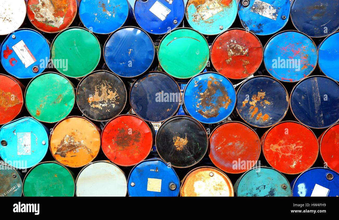 Multicolors old rusty oil barrels stack in rows Stock Photo