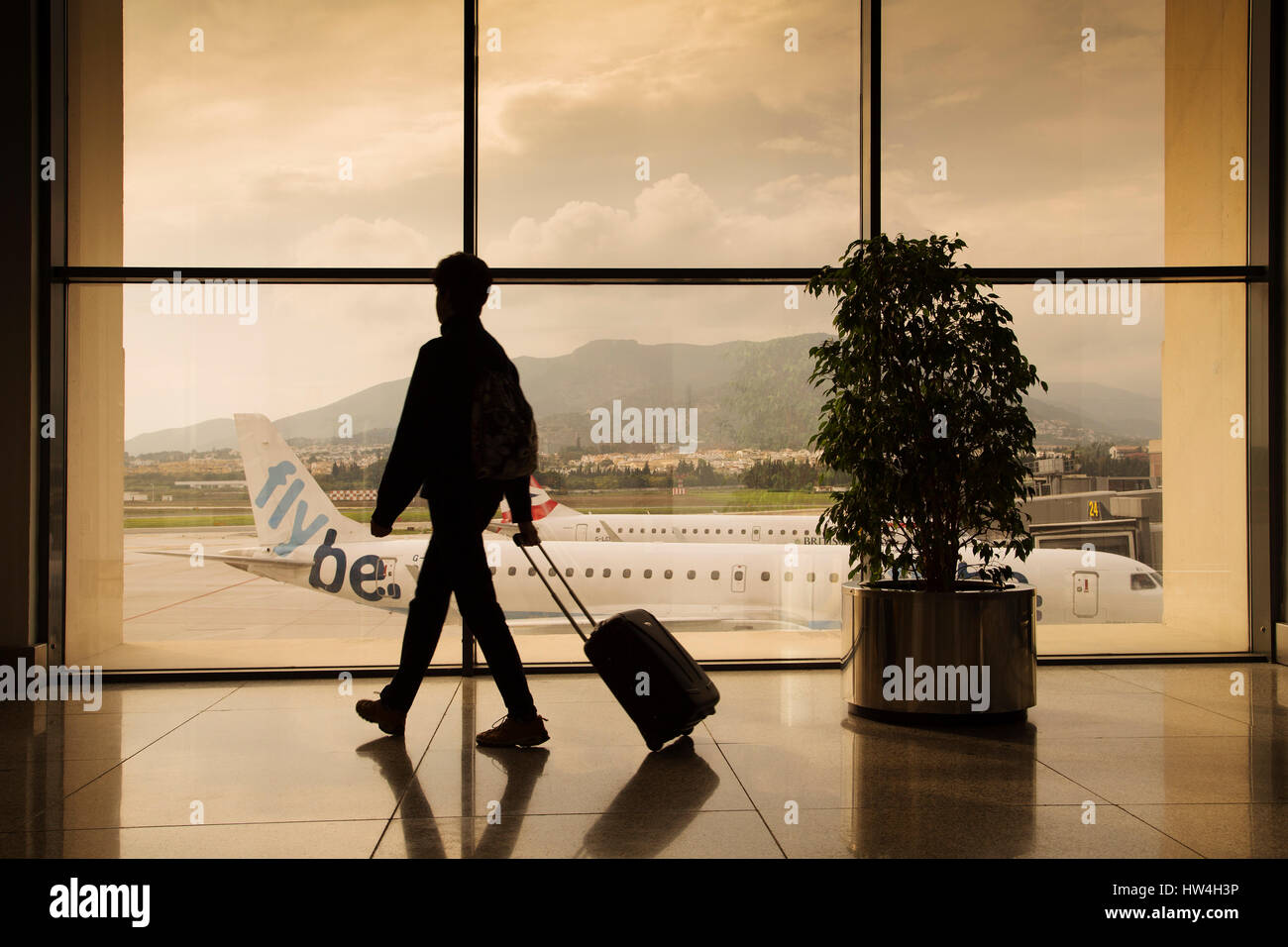 Tourist with luggage at Malaga airport. Costa del Sol, Malaga. Andalusia southern Spain. Europe - Stock Image