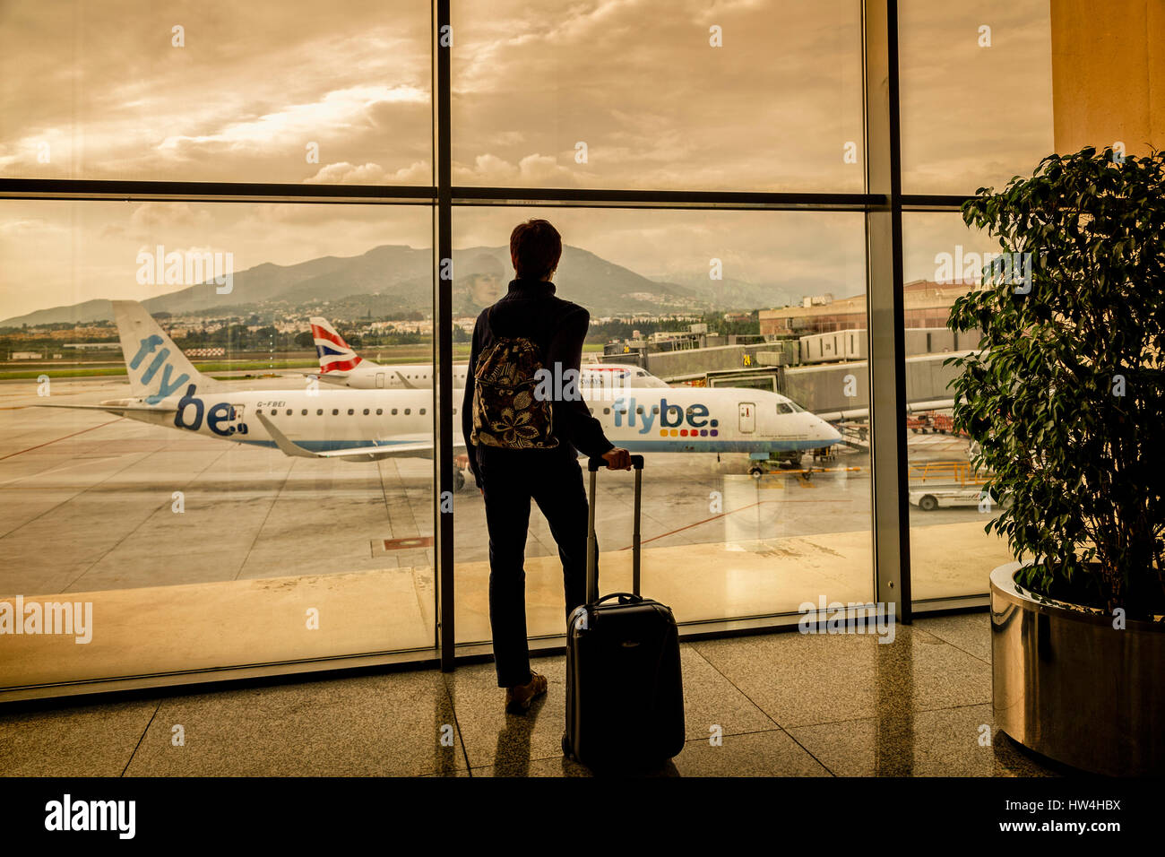 Tourist with luggage at Malaga airport. Costa del Sol, Malaga. Andalusia southern Spain. Europe Stock Photo