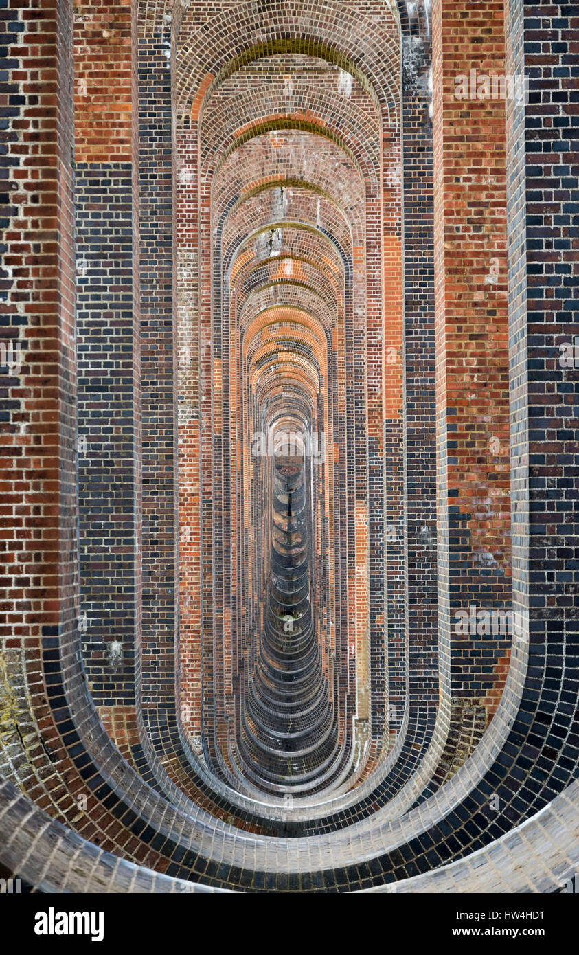 View through the brickwork and soffits of the Ouse Valley (Balcombe) Viaduct in West Sussex, UK - Stock Image