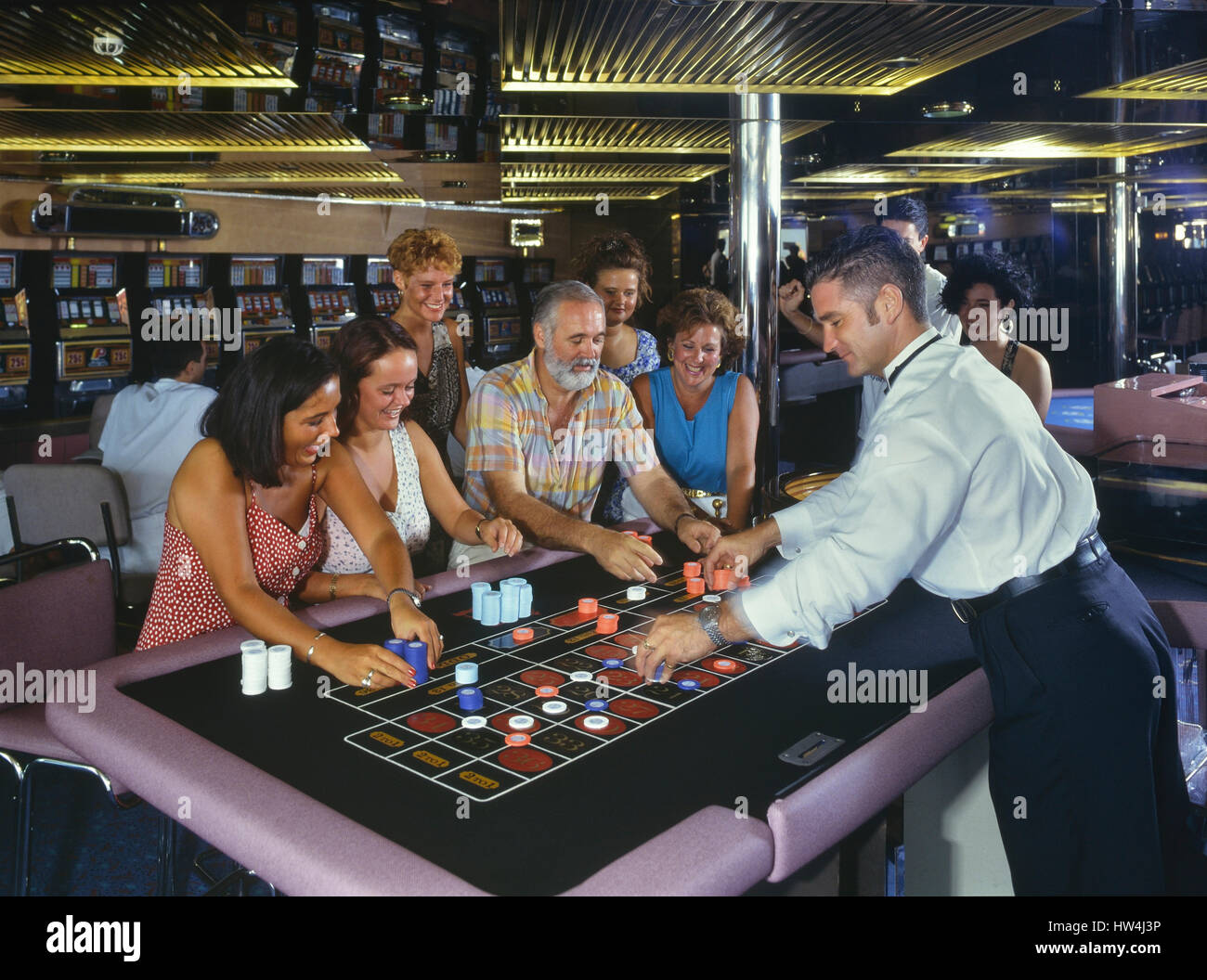 People playing at roulette in a Cruise ship casino - Stock Image
