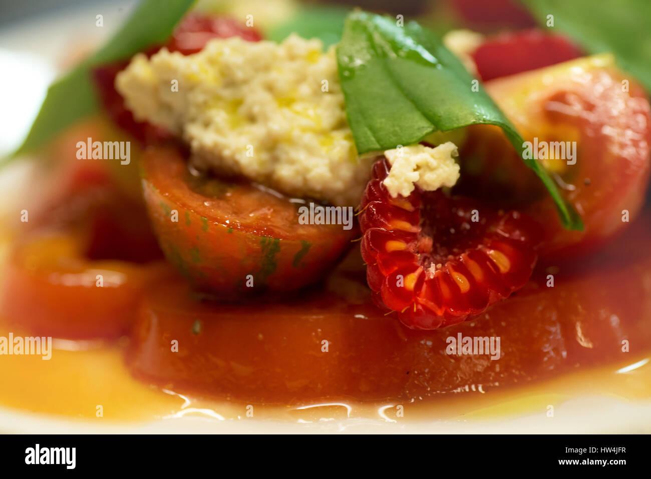 Raspberry, tomato and feta salad - Stock Image