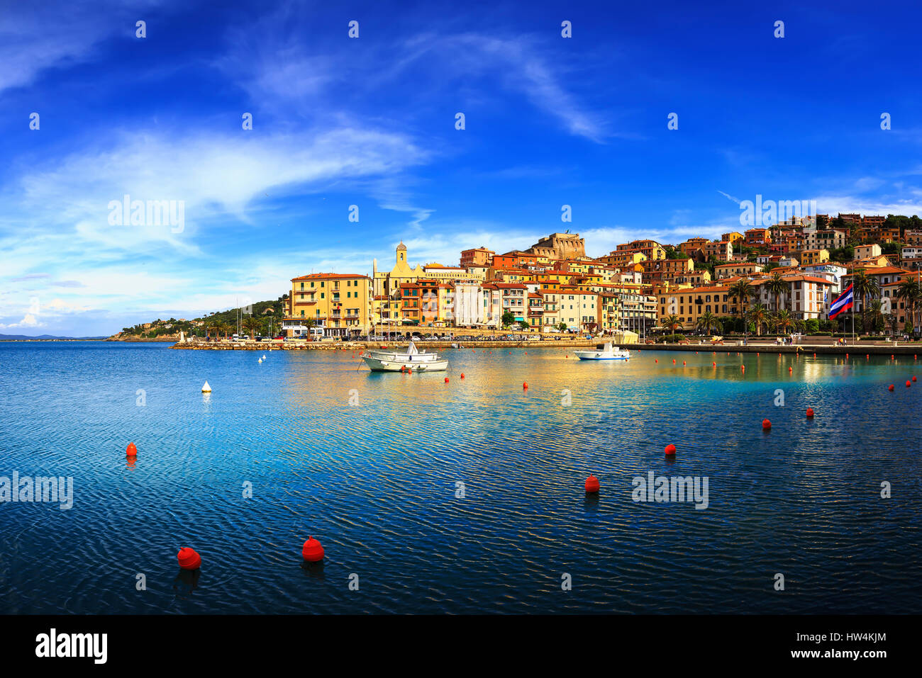 Porto Santo Stefano harbor seafront and village skyline, italian travel destination. Monte Argentario, Tuscany, - Stock Image