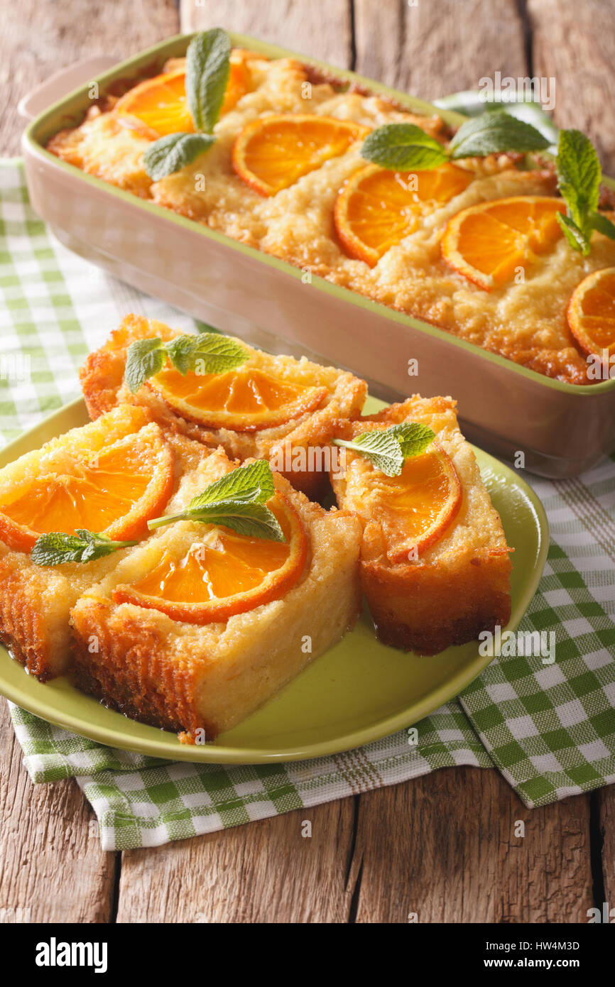 Traditional Greek Orange Pie With Phyllo - Portokalopita close-up on a table. Vertical Stock Photo