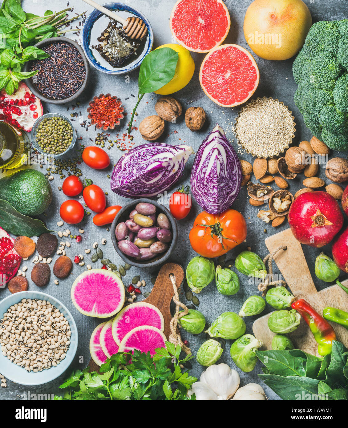 Healthy raw food variety over grey concrete background - Stock Image
