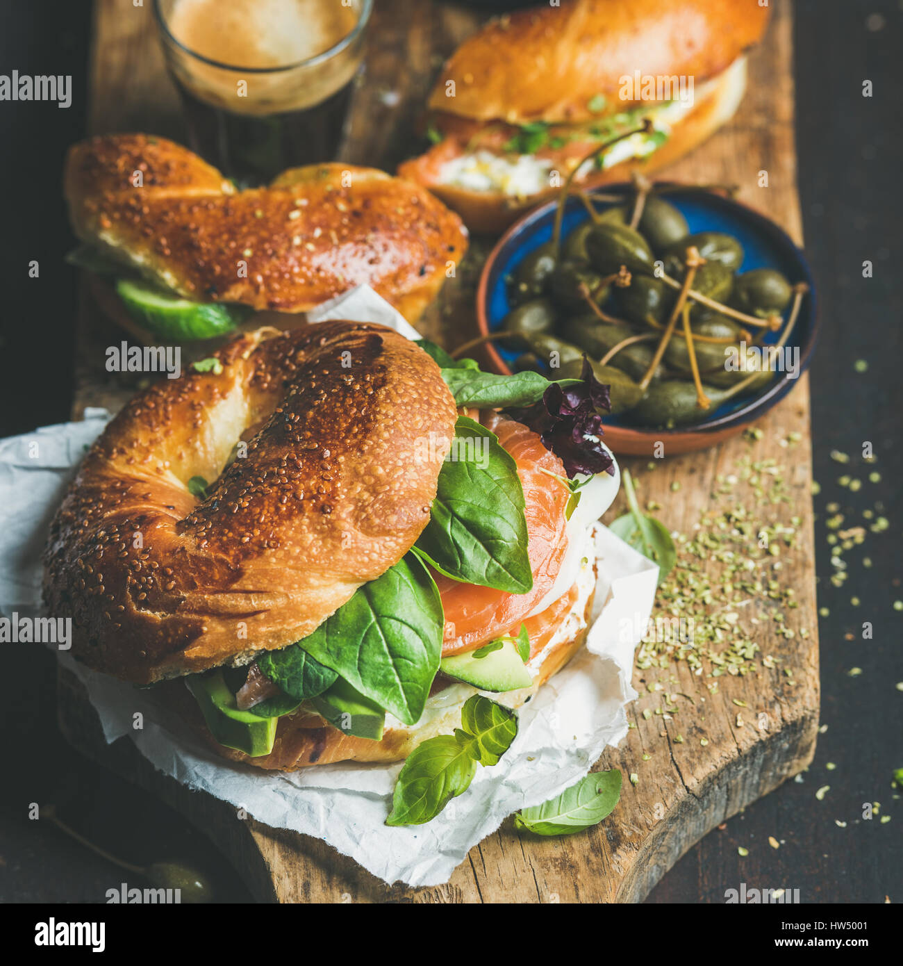 Close-up of bagels, espresso coffee in glass and capers - Stock Image