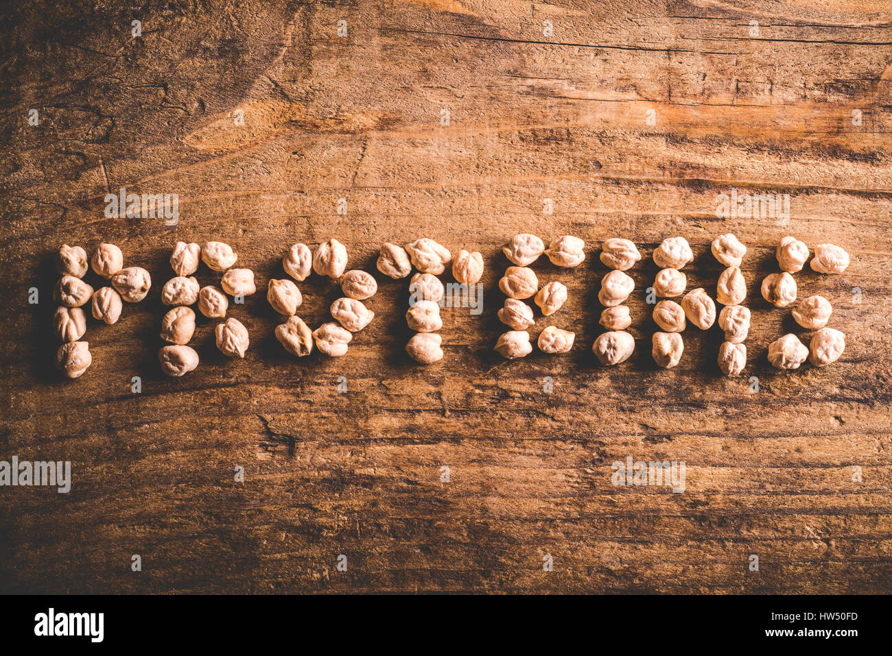 written proteins on old wooden background - Stock Image